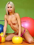 Naughty teen Sabrinka posing naked after pilates class